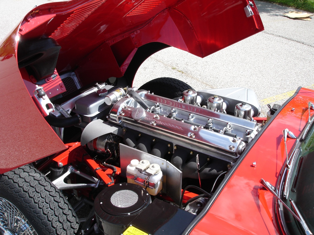 Engine of a 1967 Jaguar XKE red convertible