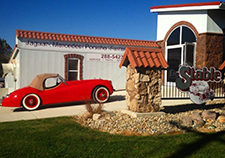 Exterior of LeStable with red convertible parked in driveway